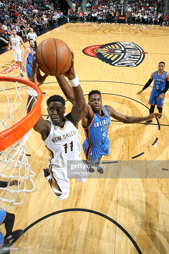 Jrue Holiday #11 of the New Orleans Pelicans goes for the dunk during the game against the Oklahoma City Thunder on January 25, 2017 at the Smoothie King Center in New Orleans, Louisiana.