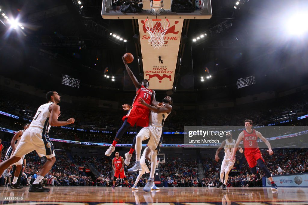 Jrue Holiday #11 of the New Orleans Pelicans goes to the basket against the Denver Nuggets on December 6, 2017 at Smoothie King Center in New Orleans, Louisiana.