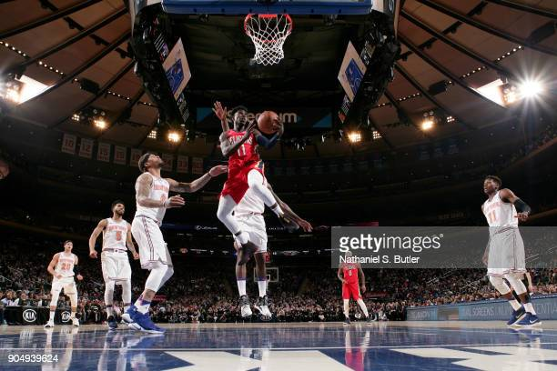 Jrue Holiday of the New Orleans Pelicans goes to the basket against the New York Knicks on January 14 2018 at Madison Square Garden in New York City...