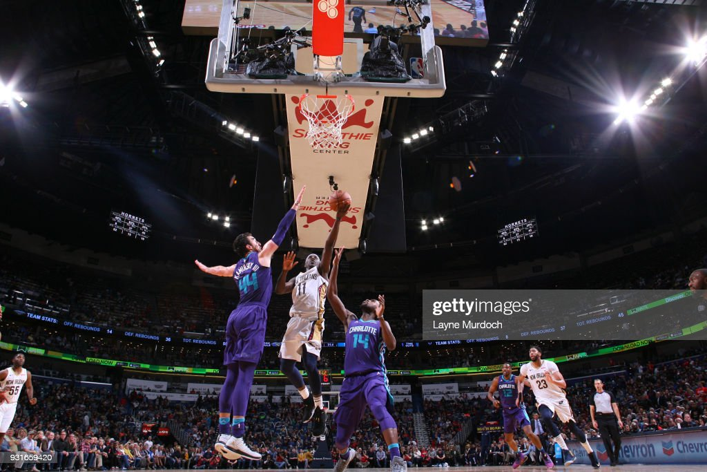 Jrue Holiday #11 of the New Orleans Pelicans goes to the basket against the Charlotte Hornets on March 13, 2018 at Smoothie King Center in New Orleans, Louisiana.