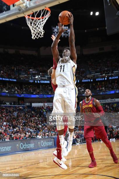 Jrue Holiday of the New Orleans Pelicans goes up for a dunk against the Cleveland Cavaliers on October 28 2017 at the Smoothie King Center in New...
