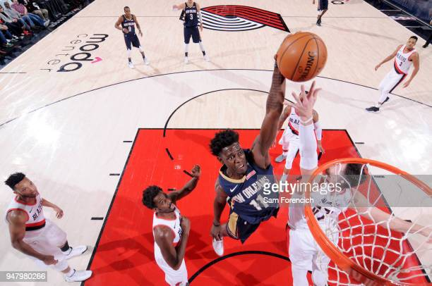 Jrue Holiday of the New Orleans Pelicans goes up for a dunk against the Portland Trail Blazers in Game Two of Round One of the 2018 NBA Playoffs on...