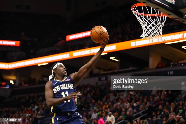 Jrue Holiday of the New Orleans Pelicans goes up for a layup in the first quarter against the Minnesota Timberwolves at Target Center on January 12...