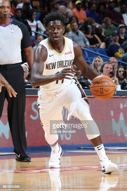 Jrue Holiday of the New Orleans Pelicans handles the ball against LeBron James of the Cleveland Cavaliers on October 28 2017 at the Smoothie King...