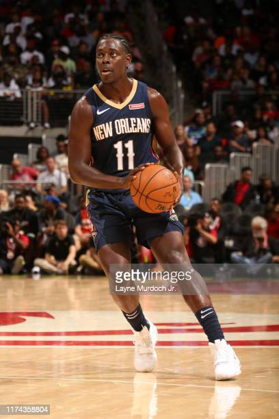 Jrue Holiday of the New Orleans Pelicans handles the ball against the Atlanta Hawks during a preseason game on October 7 2019 at State Farm Arena in...