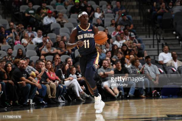 Jrue Holiday of the New Orleans Pelicans handles the ball against the San Antonio Spurs during a preseason game on October 13 2019 at the ATT Center...