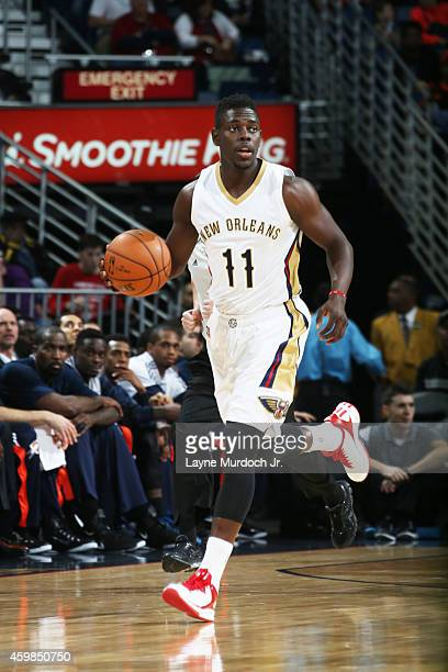 Jrue Holiday of the New Orleans Pelicans handles the ball against the Oklahoma City Thunder during the game on December 2 2014 at the Smoothie King...