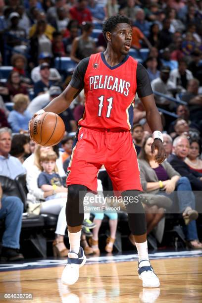 Jrue Holiday of the New Orleans Pelicans handles the ball against the Denver Nuggets on April 4 2017 at the Smoothie King Center in New Orleans...
