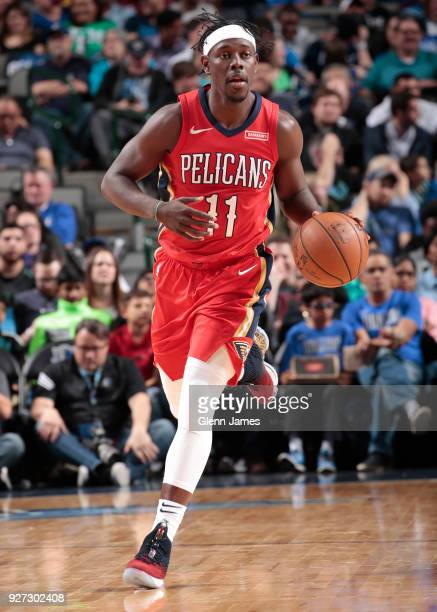 Jrue Holiday of the New Orleans Pelicans handles the ball against the Dallas Mavericks on March 4 2018 at the American Airlines Center in Dallas...