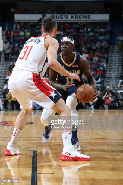 Jrue Holiday of the New Orleans Pelicans handles the ball against the Washington Wizards on March 9 2018 at Smoothie King Center in New Orleans...