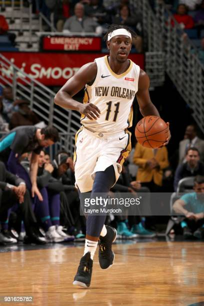 Jrue Holiday of the New Orleans Pelicans handles the ball against the Charlotte Hornets on March 13 2018 at Smoothie King Center in New Orleans...