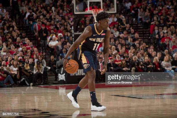 Jrue Holiday of the New Orleans Pelicans handles the ball against the New Orleans Pelicans in Game One of the Western Conference Quarterfinals during...