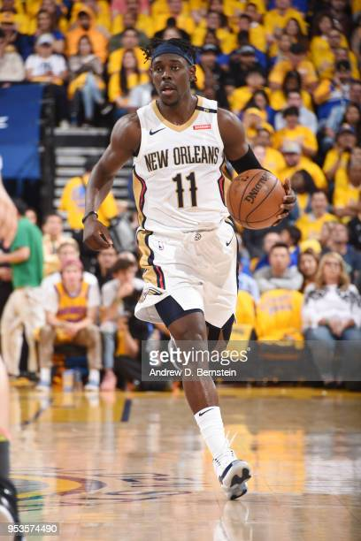 Jrue Holiday of the New Orleans Pelicans handles the ball against the Golden State Warriors in Game Two of Round Two of the 2018 NBA Playoffs on May...