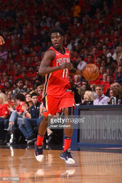 Jrue Holiday of the New Orleans Pelicans handles the ball against the Golden State Warriors in Game Three of the Western Conference Semifinals during...