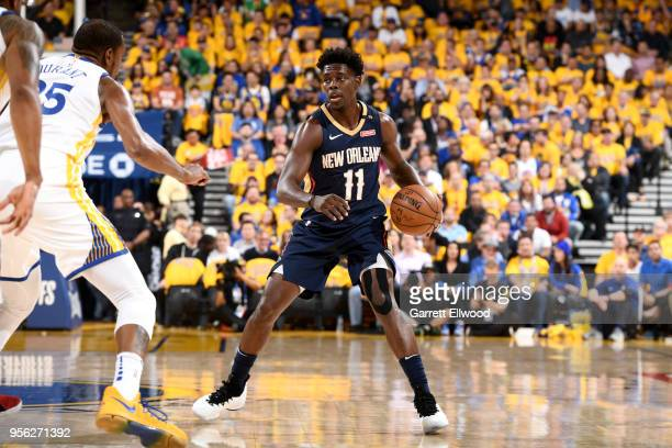 Jrue Holiday of the New Orleans Pelicans handles the ball against the Golden State Warriors in Game Five of the Western Conference Semifinals of the...