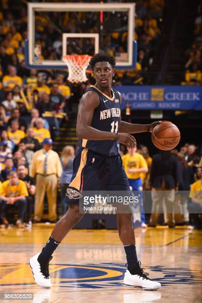 Jrue Holiday of the New Orleans Pelicans handles the ball against the Golden State Warriors in Game Five of the Western Conference Semifinals during...