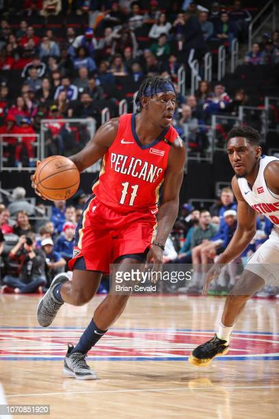 Jrue Holiday of the New Orleans Pelicans handles the ball during the game against Langston Galloway of the Detroit Pistons on December 9 2018 at...