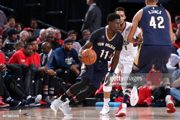Jrue Holiday of the New Orleans Pelicans handles the ball during the game against the Portland Trail Blazers on April 12 2017 at the Moda Center in...