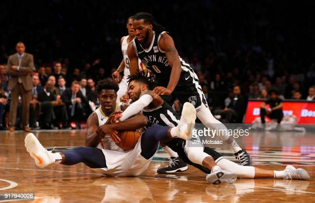 Jrue Holiday of the New Orleans Pelicans in action against D'Angelo Russell and DeMarre Carroll of the Brooklyn Nets at Barclays Center on February...