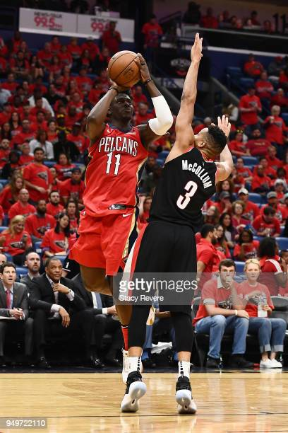 Jrue Holiday of the New Orleans Pelicans is fouled by CJ McCollum of the Portland Trail Blazers during the second half of Game Four of the first...