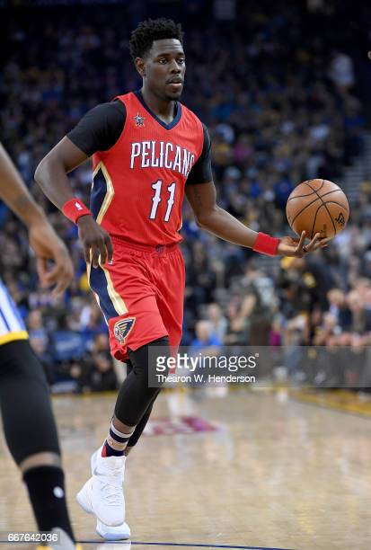 Jrue Holiday of the New Orleans Pelicans looks to pass the ball against the Golden State Warriors during an NBA Basketball game at ORACLE Arena on...
