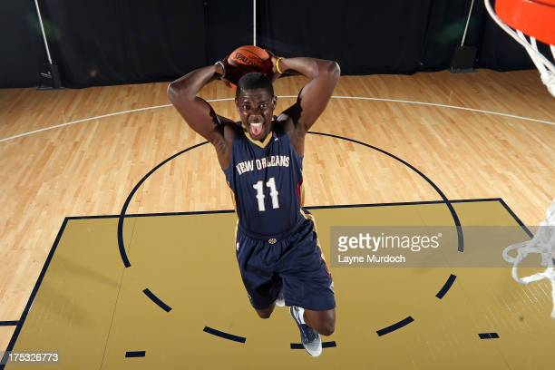 Jrue Holiday of the New Orleans Pelicans participates in a photo shoot wearing the team's new road uniform on August 1 2013 at the New Orleans...
