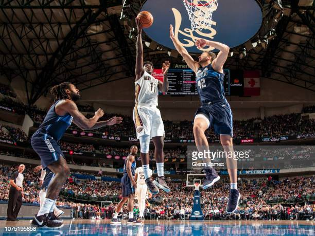 Jrue Holiday of the New Orleans Pelicans puts up shot against the Dallas Mavericks on December 26 2018 at the American Airlines Center in Dallas...