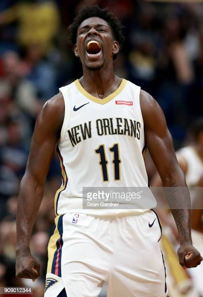 Jrue Holiday of the New Orleans Pelicans reacts after scoring a three pointer during the second half of a NBA game against the Chicago Bulls at...