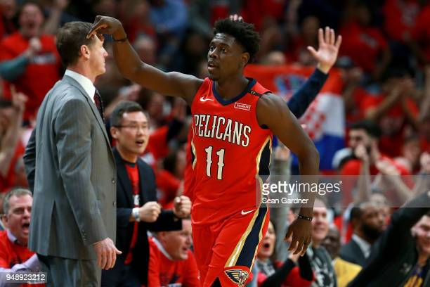 Jrue Holiday of the New Orleans Pelicans reacts after scoring a three pointer during Game 3 of the Western Conference playoffs against the Portland...