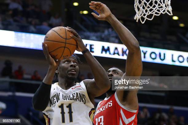 Jrue Holiday of the New Orleans Pelicans shoots against James Harden of the Houston Rockets during the first half at the Smoothie King Center on...