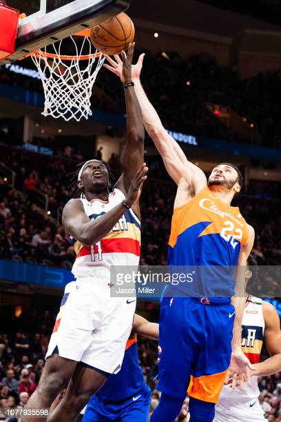 Jrue Holiday of the New Orleans Pelicans shoots over Larry Nance Jr #22 of the Cleveland Cavaliers during the first half at Quicken Loans Arena on...