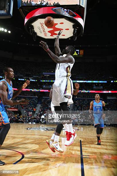 Jrue Holiday of the New Orleans Pelicans shoots the ball against the Oklahoma City Thunder during the game on December 2 2014 at the Smoothie King...