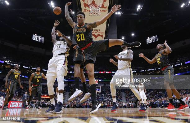Jrue Holiday of the New Orleans Pelicans shoots the ball as John Collins of the Atlanta Hawks defends during the second half of a game at the...