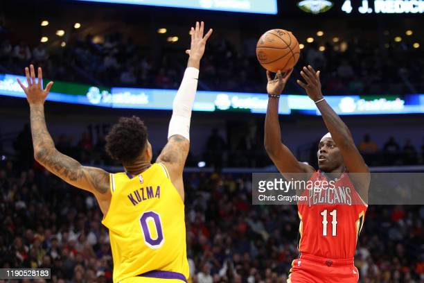 Jrue Holiday of the New Orleans Pelicans shoots the ball over Kyle Kuzma of the Los Angeles Lakers at Smoothie King Center on November 27 2019 in New...