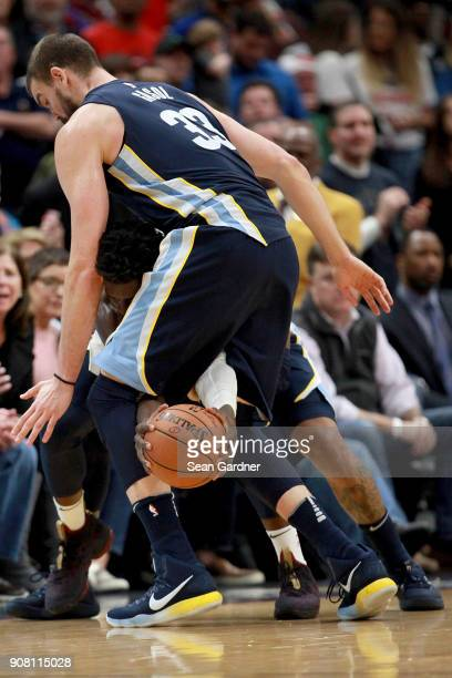 Jrue Holiday of the New Orleans Pelicans tries to dribble around Marc Gasol of the Memphis Grizzlies during the second half of a NBA game at the...
