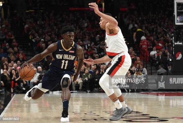 Jrue Holiday of the New Orleans Pelicans tries to get past Wade Baldwin IV of the Portland Trail Blazers during the first quarter of game one of the...