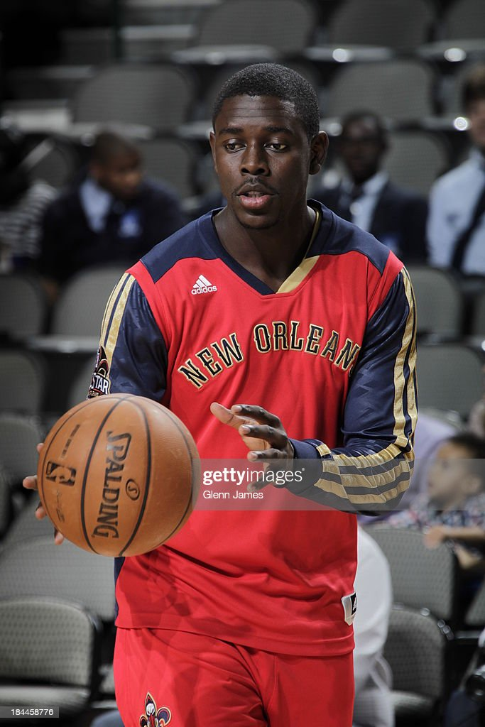 Jrue Holiday #11 of the New Orleans Pelicans warms up before the game against the Dallas Mavericks on October 7, 2013 at the American Airlines Center in Dallas, Texas.