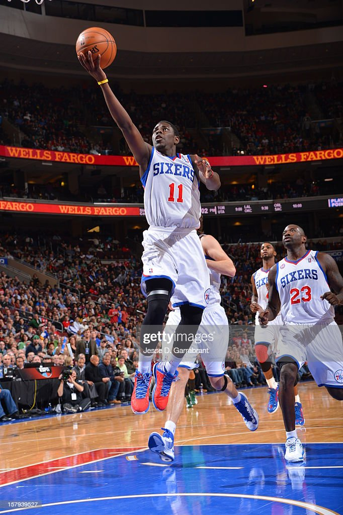 Jrue Holiday #11 of the Philadelphia 76ers drives to the basket against the Boston Celtics at the Wells Fargo Center on December 7, 2012 in Philadelphia, Pennsylvania.