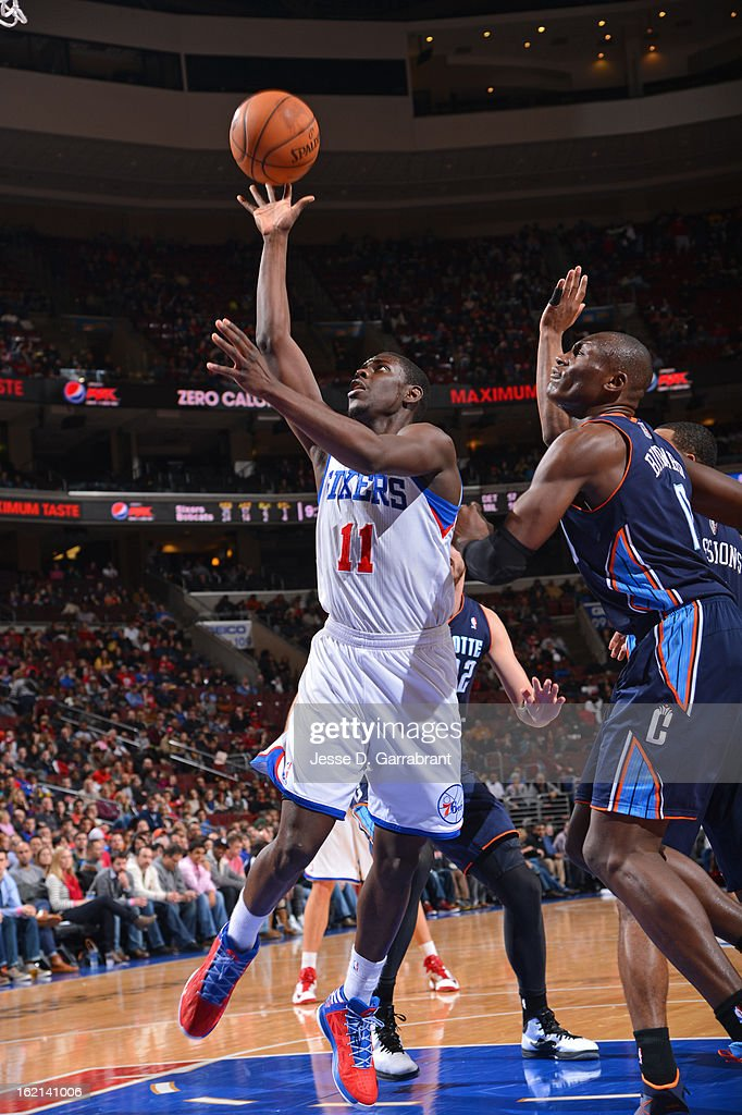 Jrue Holiday #11 of the Philadelphia 76ers puts up a shot against the Charlotte Bobcats at the Wells Fargo Center on February 9, 2013 in Philadelphia, Pennsylvania.