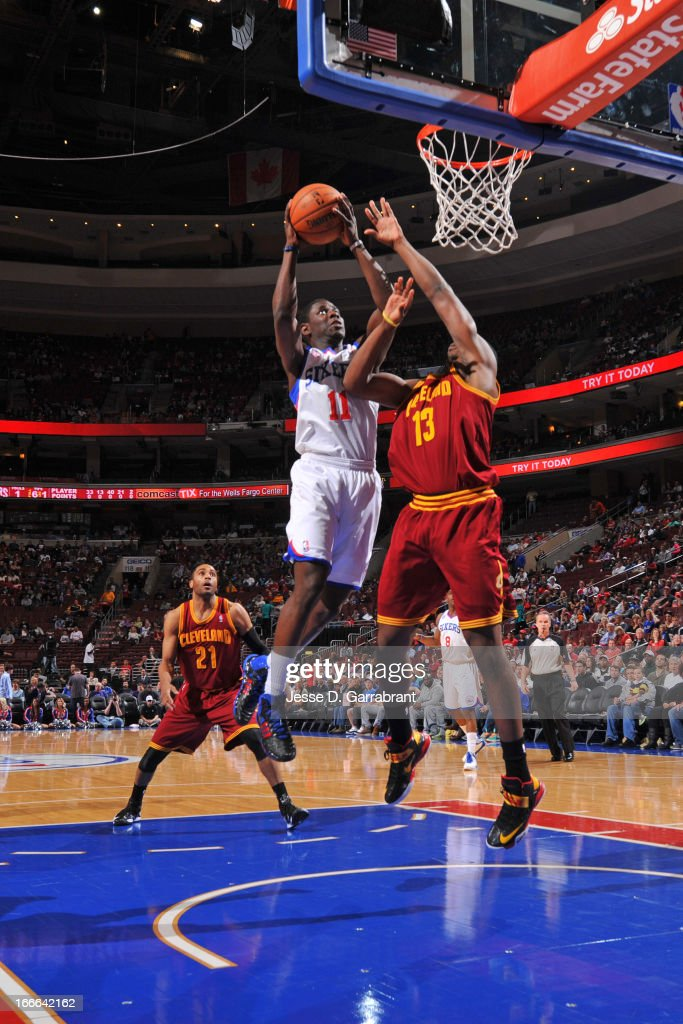 Jrue Holiday #11 of the Philadelphia 76ers shoots a layup against Tristan Thompson #13 of the Cleveland Cavaliers at the Wells Fargo Center on April 14, 2013 in Philadelphia, Pennsylvania.