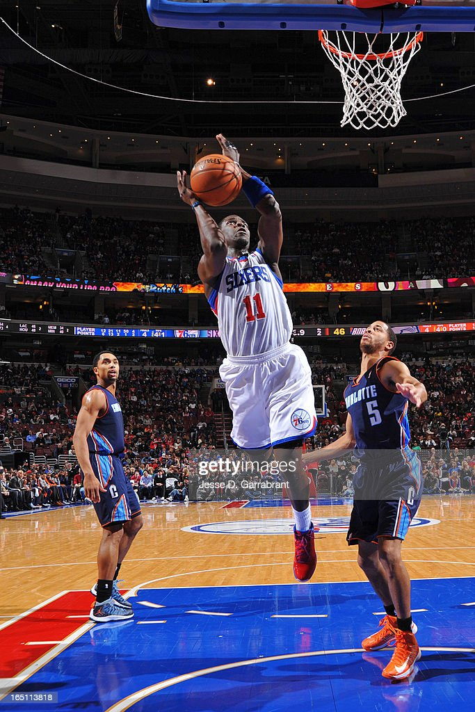 Jrue Holiday #11 of the Philadelphia 76ers shoots against Jannero Pargo #5 of the Charlotte Bobcats at the Wells Fargo Center on March 30, 2013 in Philadelphia, Pennsylvania.