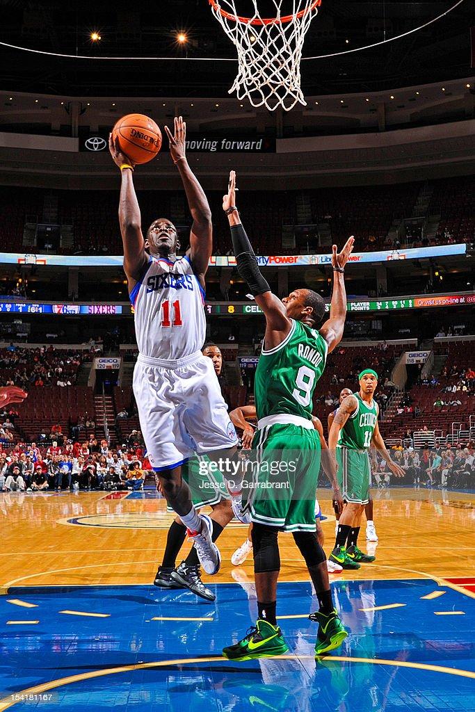 Jrue Holiday #11 of the Philadelphia 76ers shoots against Rajon Rondo #9 of the Boston Celtics during a pre-season game at the Wells Fargo Center on October 15, 2012 in Philadelphia, Pennsylvania.