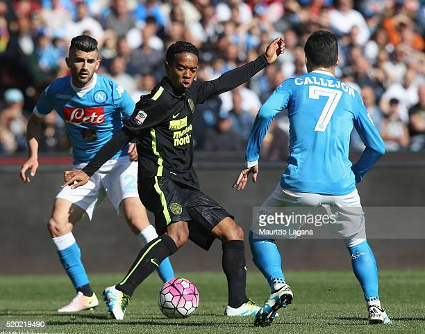 Jsè Maria Callejon of Napoli competes for the ball with Urby Emanuelson of Verona during the Serie A match between SSC Napoli and Hellas Verona FC at...