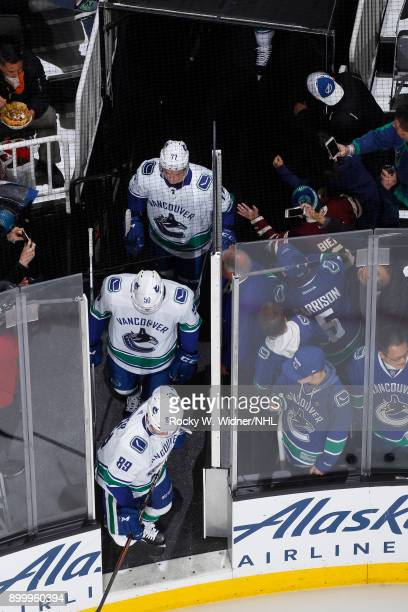 JSam Gagner Brendan Gaunce and Nikolay Goldobin of the Vancouver Canucks head onto the ice prior to the game against the San Jose Sharks at SAP...