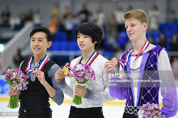 LRjSilver medalist Vincent Zhou of United States and Gold medalist Jun Hwan Cha of Korea and Bronze medalist Alexey Erokhov of Russia pose for...