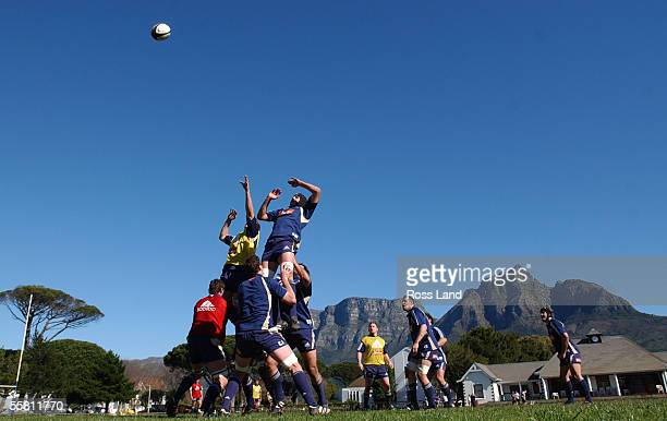 JSimon Maling and Ali Williams compete for lineout ball against a spectacular backdrop of Table Mountain during training at Bishops College Cape Town...