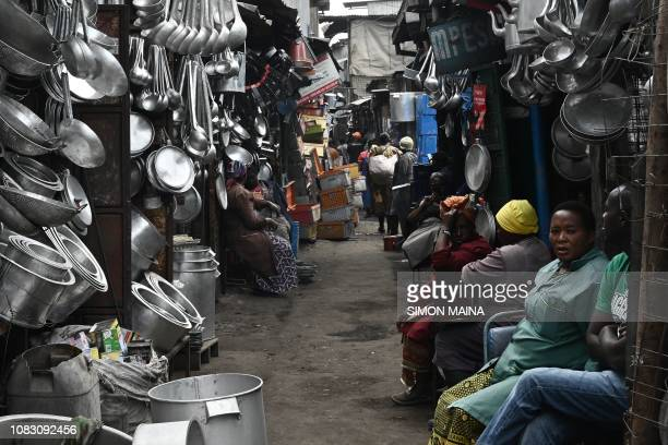 Jua Kali artisan traders sit outside their shops as they wait for customers at Gikomba Market in Nairobi Kenya January 15 2019 An estimated 831 per...