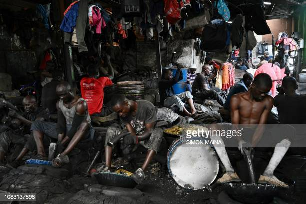 TOPSHOT Jua Kali artisans work in their shops at Gikomba Market in Nairobi on January 15 2019 An estimated 831 per cent of the country's total labour...