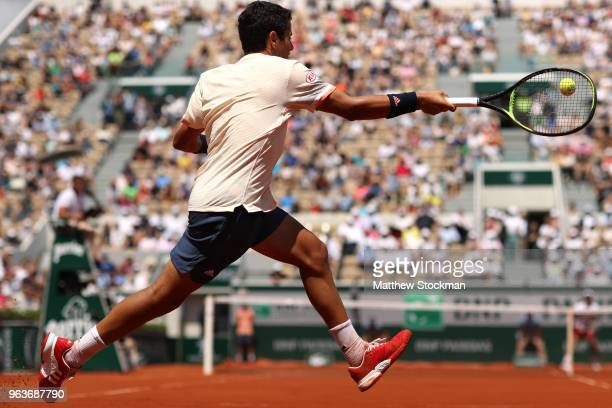 Juame Munar of Spain plays a forehand during the mens singles second round match against Novak Djokovic of Serbia during day four of the 2018 French...