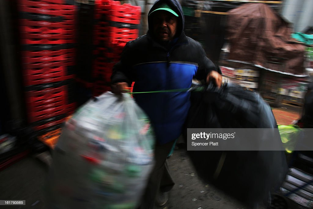 'Juan', a man who makes a living by collecting bottles and cans or 'canning' for short, moves an evenings collection to be counted and sorted at Sure We Can, a non-profit bottle redemption center in Bushwick, Brooklyn that is pushing to become a cooperative for the canning community on February 16, 2013 in New York City. Sure We Can, which was partly started by homeless canners in 2007 and is run by one of its founders Sister Ana Martinez de Luco, looks to give the diverse members of the canning community a safe and fraternal place to redeem cans, store their carriages and become members of an association that encourages self-dependence and responsibility. Many of New York's canners are non-English-speaking elderly immigrants who live a marginalized existence and are vulnerable to dishonest business practices. Sure We Can currently serves around 50 canners per day and recycles over 6 million bottles and cans per year.
